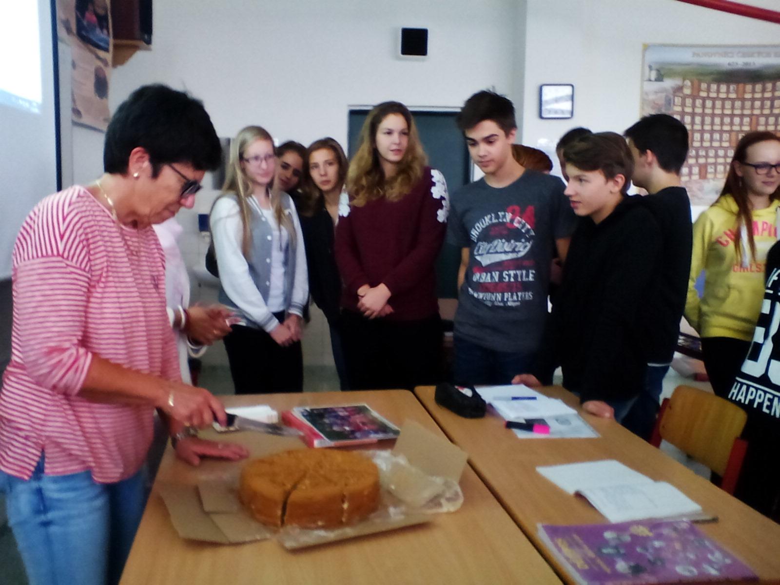 Kanishka's School principal cutting the cake with his classmates